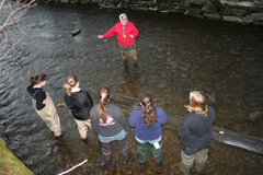 Naturalist Tom Lake teaches a group of students in the Hudson