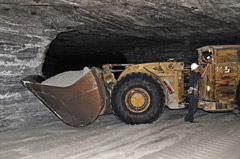 A front-end loader transporting salt in the mine