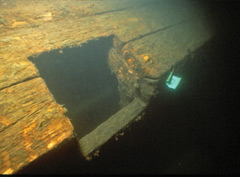 The cannon port of an underwater shipwreck