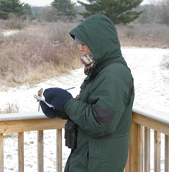 A winter bird count participant keeps notes
