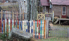 A picket-style fence made from old skis