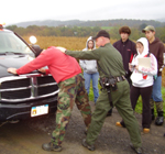 A DEC Conservation Officer demonstrates a mock arrest for onlooking students