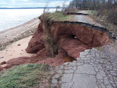 Large portion of the paved surface of a coastal road collapsed