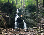 A small cascade flows over rocks
