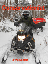 A DEC Forest Ranger on a snowmobile is featured on the cover of the February 2016 Conservationist.