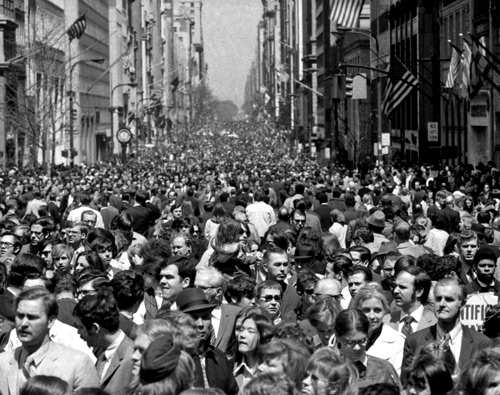 Huge crowds of people celebrating Earth Day in 1970 on Fifth Avenue in Manhattan