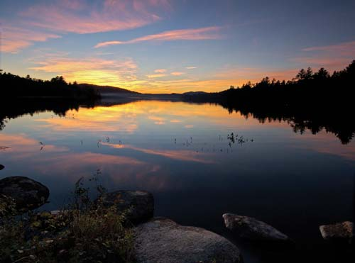 scenic sunset over Adirondack lake