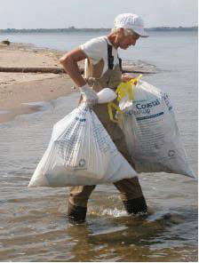 man carrying trash bags