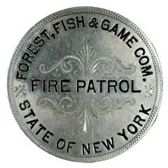 A silver-colored fire patrol pin