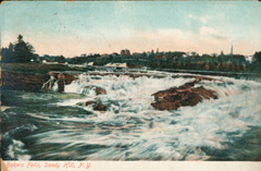 Old postcard of a waterfall with large rocks