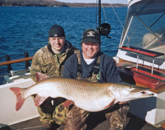 An angler demonstrates the proper way to hold a large musky -horizontally