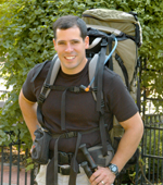 A man with a large backpack and hiking poles