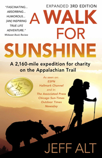 The book cover of A Walk For Sunshine showing a hiker's silhouette and animals following