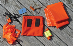 A basic emergency kit with temporary shelter (contractor trash bag),fire starter and signaling device