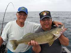 anglers holding large walleye