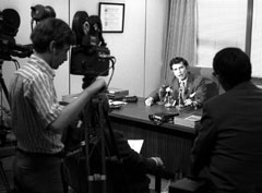 A television crew films Henry Diamond in his office