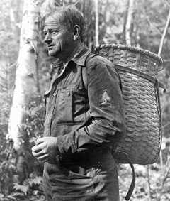A forest ranger wearing a pack basket