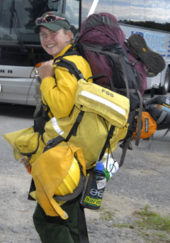A woman forest ranger with a large backpack