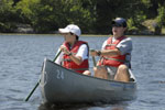 Two people paddling a canoe