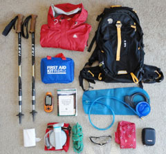 Things to pack including backpack, rain shell, poles and first aid kit.