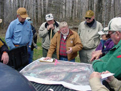 A group of forest stewards consults a map