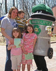 kids with person dressed in a waste can costume