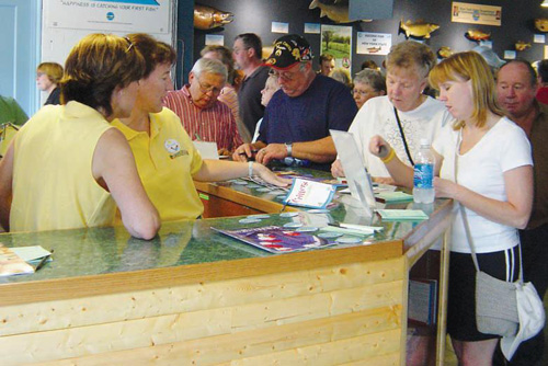 DEC employees staff the magazine's booth at the fair in summer 2006