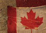 A piece of fabirc with a red maple leaf imprinted on it