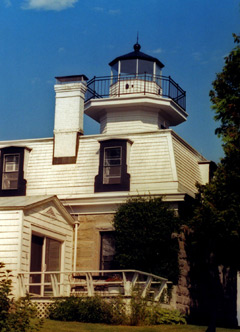 White, wooden clapboard-sided lighthouse