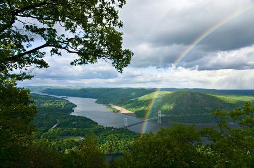 A view of the Hudson highlands including the Bear Mountain Bridge and a rainbow