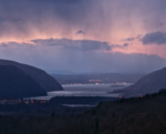 A view of the Hudson River and surrounding highlands at sunset