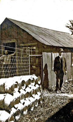 An old photo of the Rome hatchery and the milk cans used for stocking fish