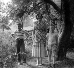 Black and white photo of the author, mother and brother