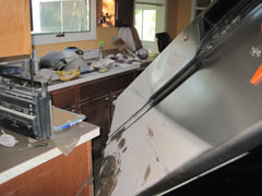 A kitchen badly damaged by a flood