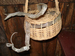 A shed snake skin woven into a basket