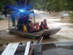 DEC forest rangers rescue people from floodwaters using an airboat