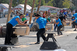 Women in blue shirts compete in the crosscut competition