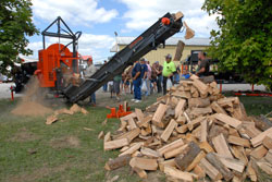 A large piece of wood processing equipment in action