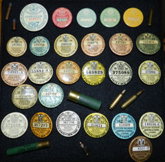 A collection of hunting license buttons
