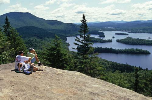 Hikers take a rest at a scenic Adirondack overlook