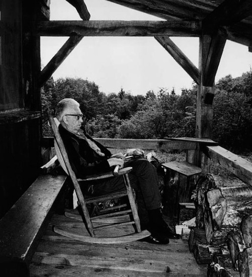 Paul Schaefer on the porch of his cabin in the Adirondacks
