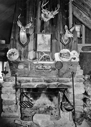 The fireplace at Beaver House camp showing Schaefer's invention, the Adirondack cooking crane