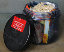An open bear-resistant cannister with food inside