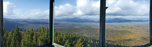 Panoramic view of forested mountains from a fire tower
