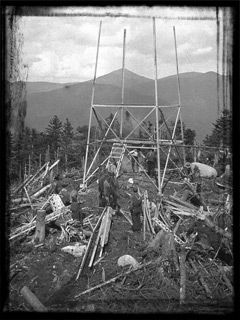 A steel fire tower under construction