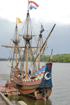 A replica of the Half Moon docked on the river
