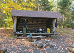 A hiker in a lean-to in the Adirondacks