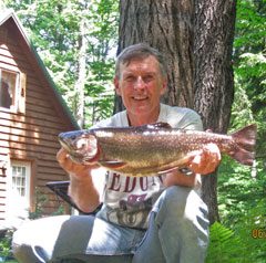 Don Germain poses with his state record brook trout
