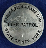 A silver-colored fire patrol button from the former New York Forest Fish and Game Commission