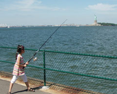 A young girl fishing in New York harbor